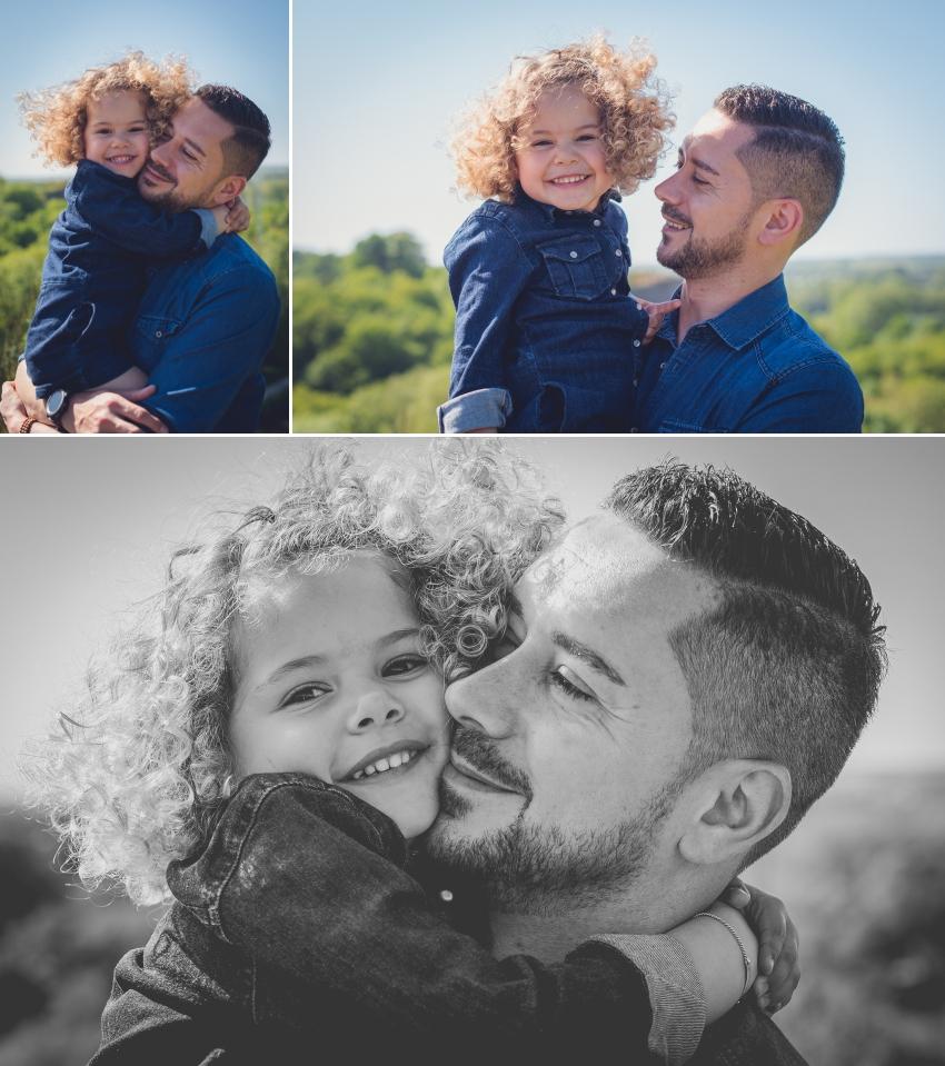 un papa et sa fille font des câlins